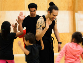 Kaiwhakaako Māori giving high fives to learners