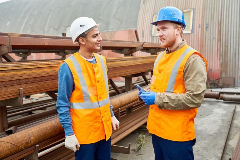 Two engineers talking in a railway yard