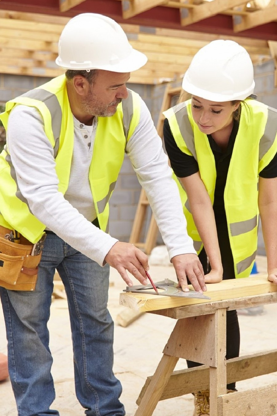 A construction manager directs an apprentice