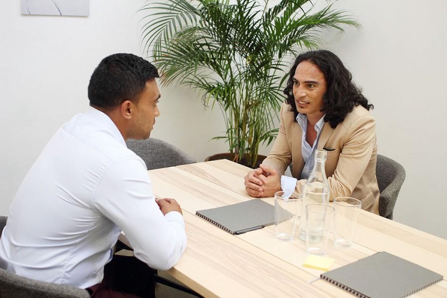 An employer interviews a job candidate
